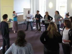 Group workshop people doing breathing exercises